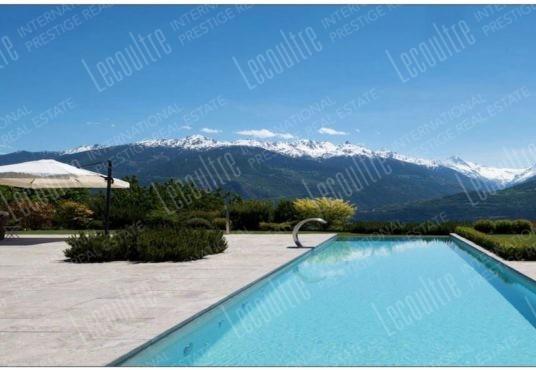 Maison contemporaine Valais piscine extérieur